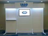 "Get up to a 50"" Monitor on our 343 trade show booth shown here with a 40""TV"