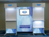 "Econ-36 trade show booth with a 32"" flatscreen...really enriches your trade show booth"